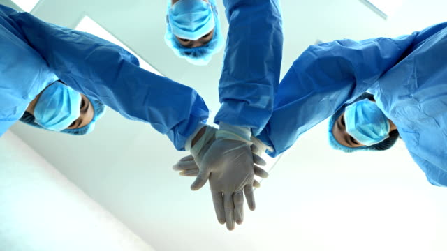 4k medical surgeons teamwork in operation room - surgeon stock videos & royalty-free footage