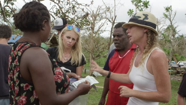 Vanuatu - March 31, 2015: Medical team discusses with patient's family