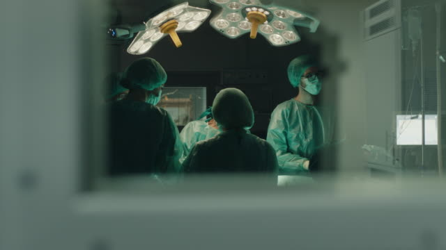medical team performing surgical operation - rubber glove stock videos & royalty-free footage