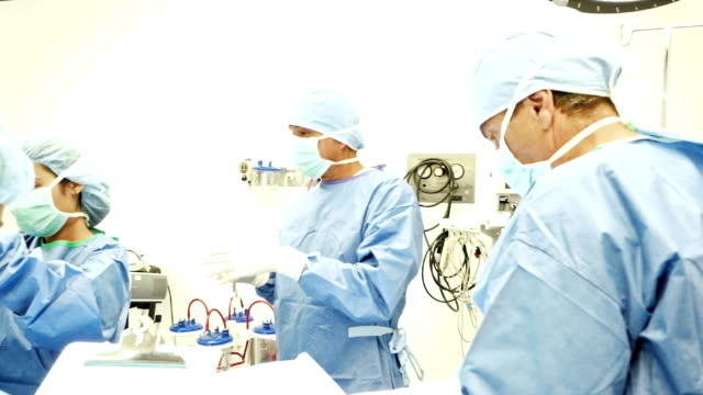 Medical team prepares patient for surgery in operating room
