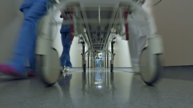 POV Medical team pushing a stretcher down the hospital hallway