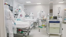 Medical Team Rolling Senior Male Patient into ICU