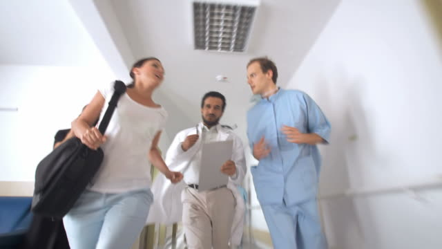 HD: Medical Team Rushing Down A Hallway