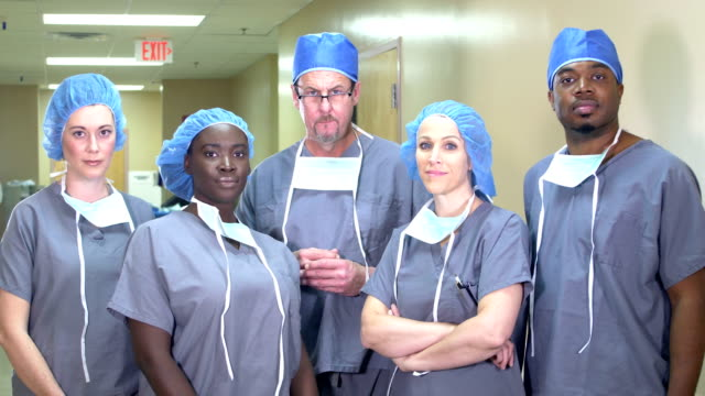 medical team standing in hospital corridor - female nurse stock videos & royalty-free footage