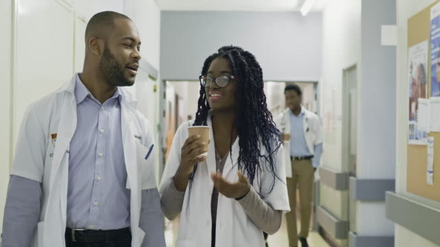medical team walking down hospital corridor - medical student stock videos and b-roll footage