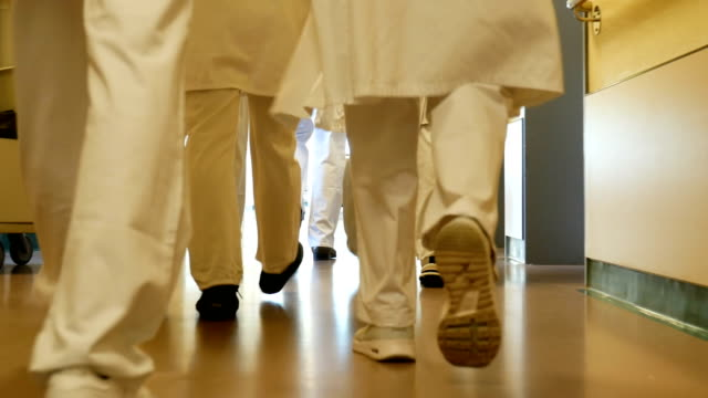 Medical team walking in corridor at hospital