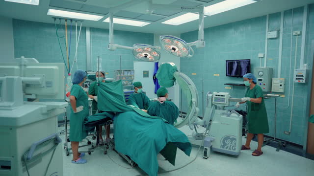 medical team working in operating room. - operating stock videos & royalty-free footage