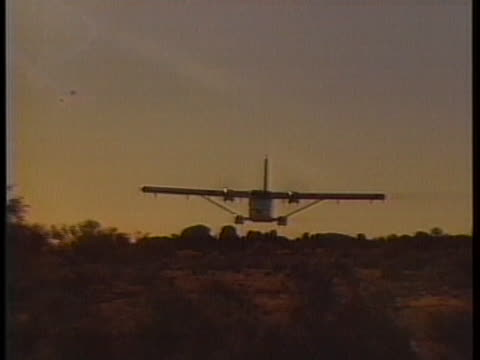 medical transport airplane flies low over meekatharra, australia. - healthcare and medicine or illness or food and drink or fitness or exercise or wellbeing stock videos & royalty-free footage