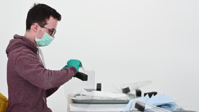 medical visors for nhs workers are made at the royal mint on march 28, 2020 in llantrisant, wales. engineers at the royal mint, who are best known... - 王立鋳貨局点の映像素材/bロール