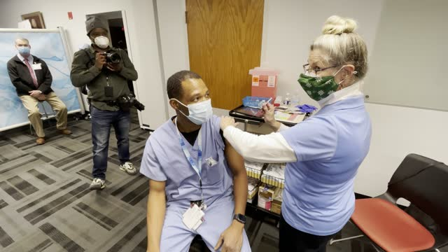medical workers receive the pfizer vaccine for covid-19 at the virginia hospital center december 16, 2020 in arlington, virginia. more than 1,950 of... - arlington virginia stock videos & royalty-free footage