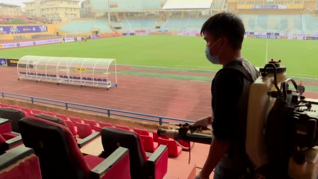 medical workers spray disinfectant at hanoi's hang day stadium to prepare for the season opening round of matches in the vleague 2020 football league - north vietnam stock videos & royalty-free footage