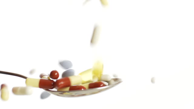 HD SLOW MOTION: Medicaments Falling On A Spoon