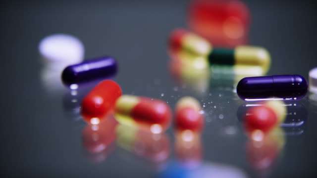 medication helps to cure, halt and prevent illness - painkiller stock videos & royalty-free footage