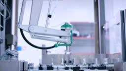 Medicine package on conveyor belt at pharmaceutical factory. Packaging line