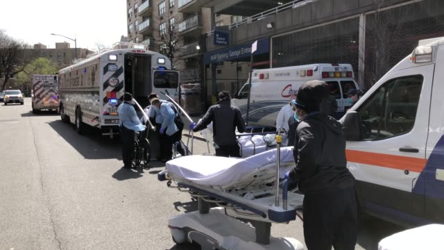 medics and hospital workers tend to a covid19 patient outside the montefiore medical center moses campus on april 07 2020 in the bronx borough of new... - bronx stock videos & royalty-free footage