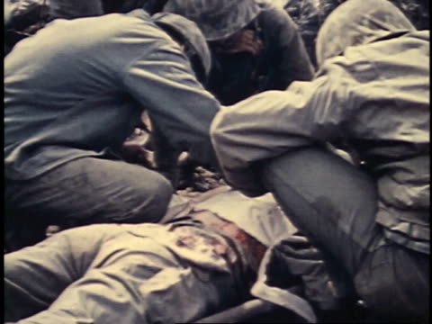 medics bandaging / transfusion / stitching - battle of iwo jima stock videos and b-roll footage
