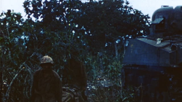 ts medics carrying injured soldier on stretcher / saipan mariana islands - mariana islands stock videos and b-roll footage