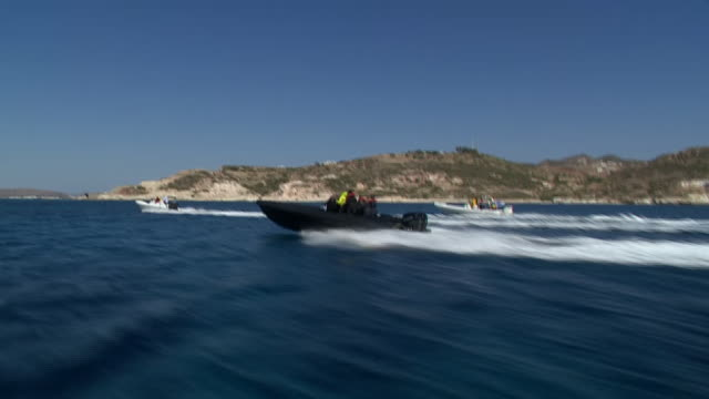 medics from mainland greece travelling to the island of milos to assist with the coronavirus crisis - recreational boat stock videos & royalty-free footage
