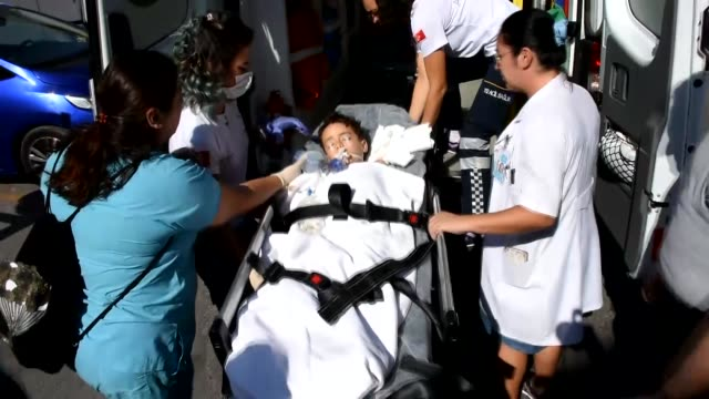 medics transfer a kid who has been injured when a boat carrying irregular migrants sank off the coast of bodrum to a hospital in izmir province on... - mugla province stock videos & royalty-free footage