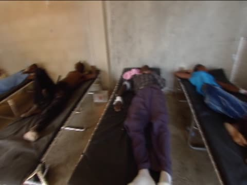 medics treat patients and crowds await treatment following the cholera outbreak in the earthquake aftermath - vibrio stock videos & royalty-free footage