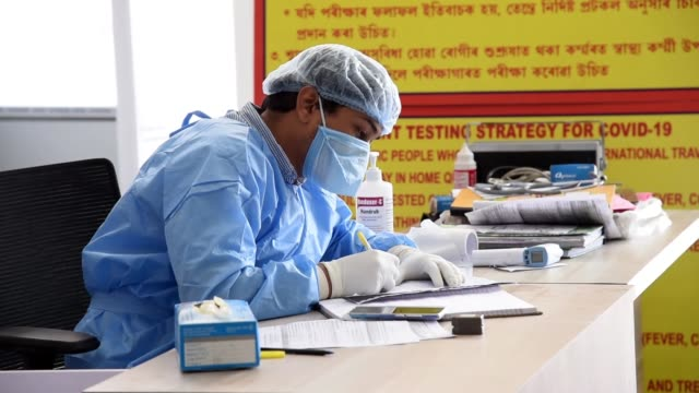 medics wearing a protective suit ready to collect swab sample - roadside stock videos & royalty-free footage