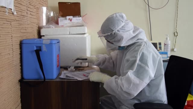 medics wearing a protective suit ready to collect swab sample - infectious disease stock videos & royalty-free footage
