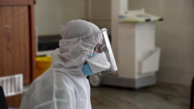 medics wearing a protective suit ready to collect swab sample - exam stock videos & royalty-free footage