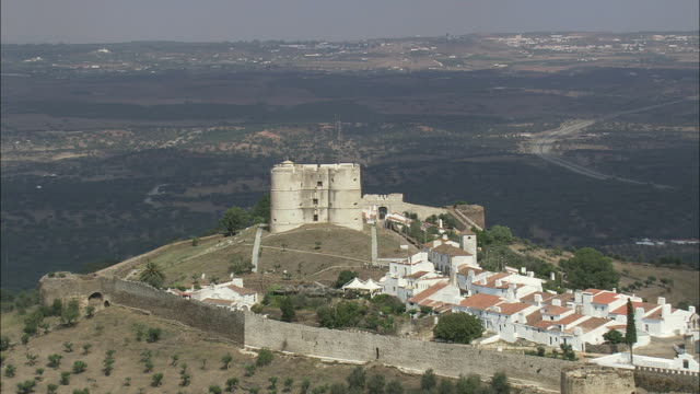 AERIAL WS TD Medieval castle wall embracing small village / Evora Monte, Evora, Portugal