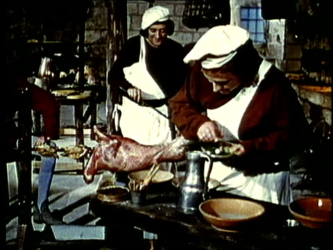 recreation, montage, medieval cooks preparing food in castle kitchen - periodo medievale video stock e b–roll