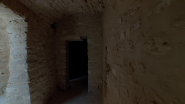 ms, pov, medieval corridors of monastery, monastir, tunisia - stone material stock videos & royalty-free footage