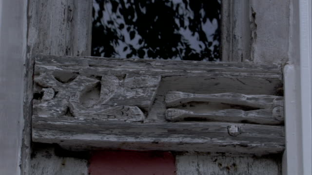 a medieval cottage features a carved beam under a window. available in hd. - lavenham stock-videos und b-roll-filmmaterial