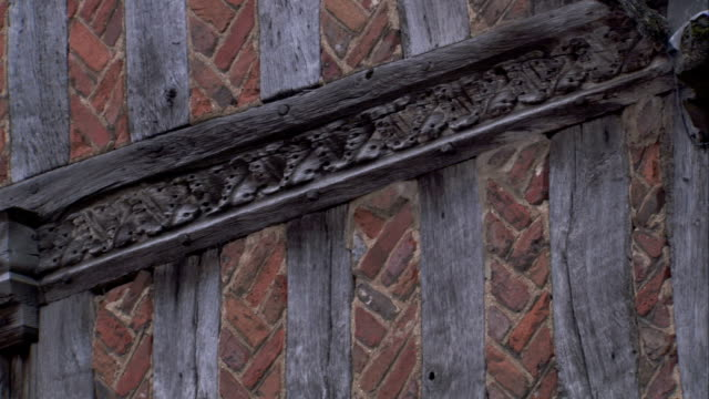 a medieval cottage features carved wooden beams and bricks. available in hd. - lavenham stock-videos und b-roll-filmmaterial