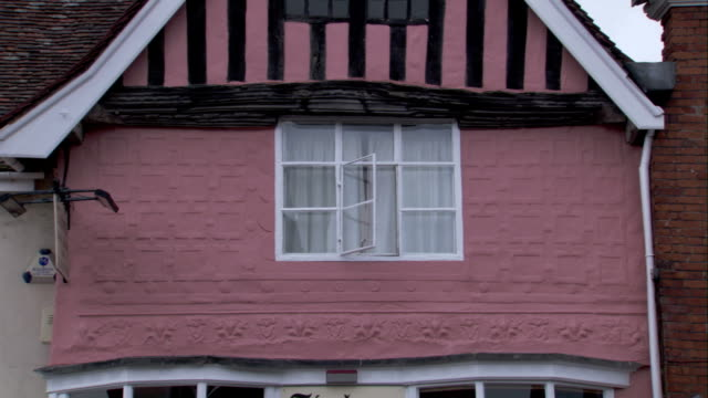 a medieval cottage features ornate architectural imprints and wooden beams. available in hd. - lavenham stock-videos und b-roll-filmmaterial