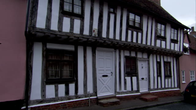 a medieval cottage features wooden beams on its exterior. available in hd. - lavenham stock-videos und b-roll-filmmaterial