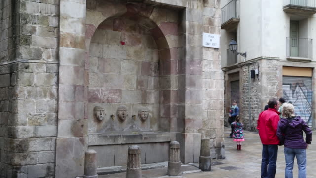 Medieval fountain's faces by Joan Fiveller, Barcelona
