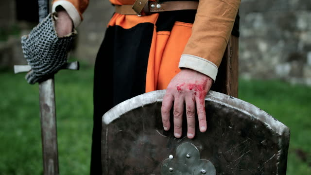 medieval knight after the battle. blood on the arm.real injury - knights templar stock videos and b-roll footage