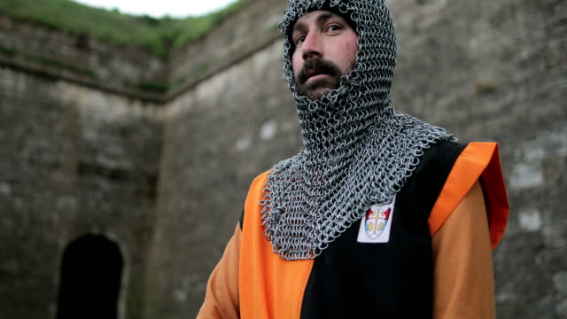 medieval knight after the battle. blood on the arm.real injury - traditional helmet stock videos and b-roll footage