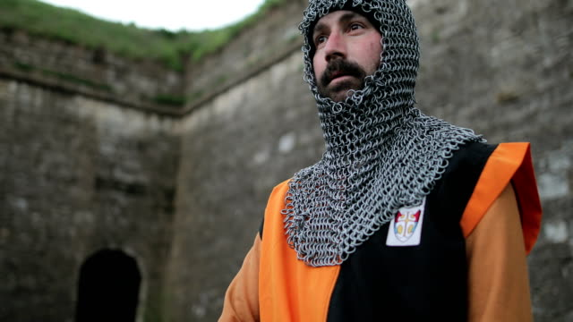 medieval knight after the battle. blood on the arm.real injury - traditional armor stock videos and b-roll footage