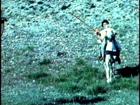 1956 reenactment montage medieval knight on horseback practising jousting with a wooden figurine  - jousting stock videos and b-roll footage