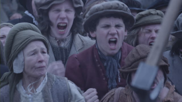 a medieval mob shouting. - periodo medievale video stock e b–roll