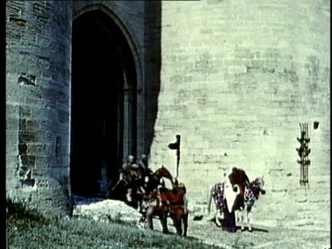 RECREATION, WS, Medieval nobleman and knights exiting castle