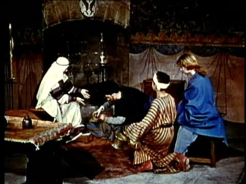 vídeos y material grabado en eventos de stock de recreation, ws, medieval noblewomen inspecting fabrics in castle room - signo de puntuación