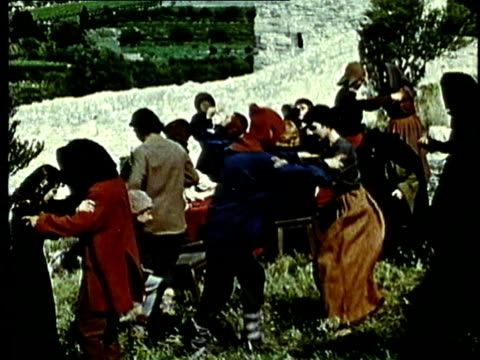 recreation, montage, medieval peasants dancing on field - historische nachstellung stock-videos und b-roll-filmmaterial