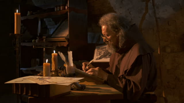 hd: medieval scribe writing by candlelight - author stock videos & royalty-free footage