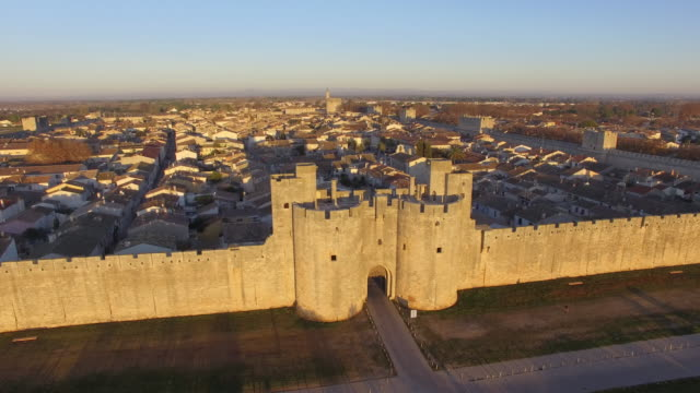 Medieval town of Aigues-Mortes, Camargue, Gard, France in the morning by drone
