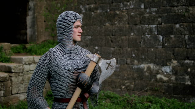 medieval warrior with chain mail armour and axe - warrior person stock videos & royalty-free footage
