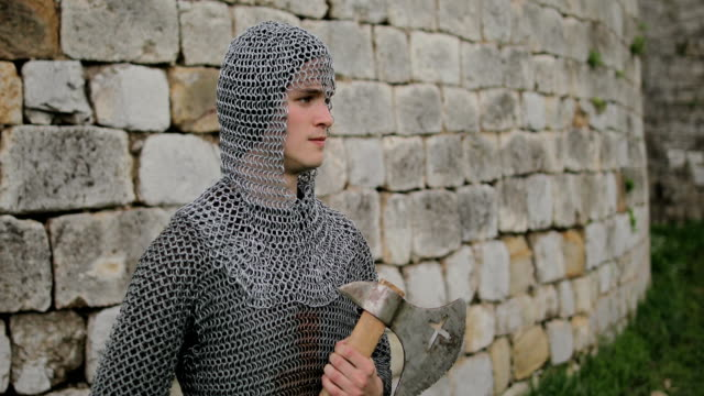 medieval warrior with chain mail armour and axe - traditional armor stock videos and b-roll footage