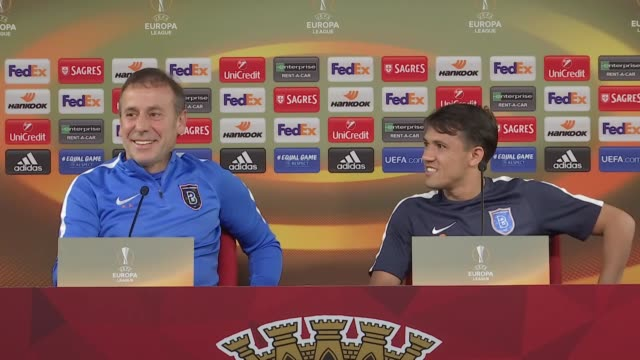 Medipol Basaksehir's head coach Abdullah Avci and midfielder Mossoro attend a press conference on the eve of their UEFA Europa League Group C...