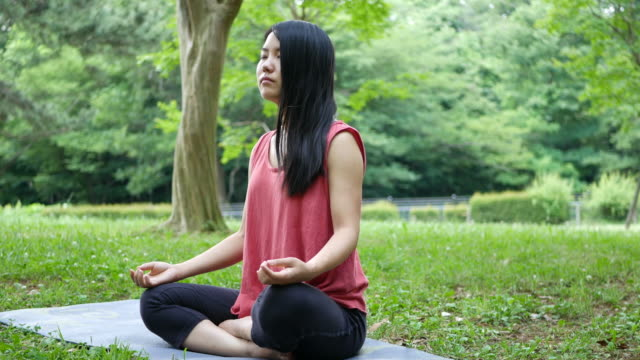 meditating and mental wellness - person cross legged stock videos & royalty-free footage