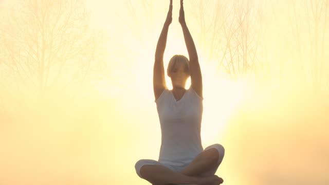 HD DOLLY: Meditating At Sunrise In Fog